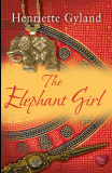 book cover for The Elephant Girl by Henriette Gyland. Red and gold background with image of a dagger and and an elephant pendant