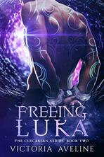 Book cover for Freeing Luka by Victoria Aveline, a sci-fi romance edited by Romance Refined editor Rachel Daven Skinner. Image of a muscular man's bank covered in swirling tattoos with his hands bound behind his back.